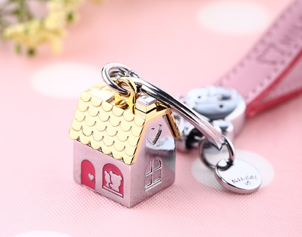 leather + zinc alloy house keychain