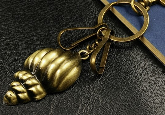 Bronze conch shell keychain